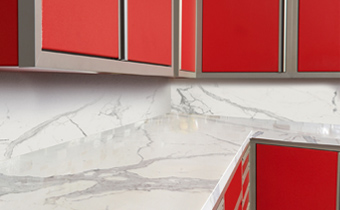 Red cabinets and marble surface